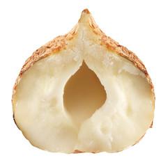 Half of hazelnut isolated on a white background.