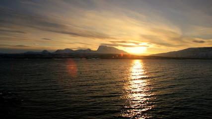 Winter snow Norwegian Fjord nr Tromso shoreline fading sunlight scenic