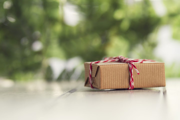 Gift box with paper kraft, tied with red & white baker's twine