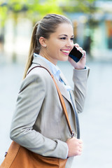 Young businesswoman with mobile phone