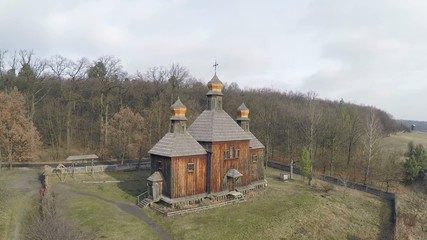 Aerial view of the mysterious church, in a thick dark forest