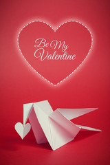 valentines day background with origami dove and hearts