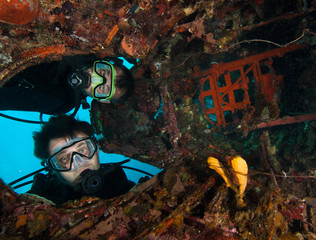 Scuba divers explore the underwater aircraft wreck