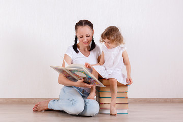 Mother and child reading the books.
