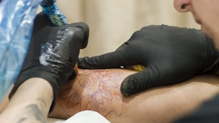 Woman being tattoed