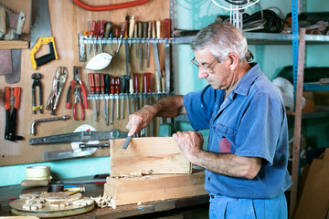 cabinetmaker filing in the bench in garage at home