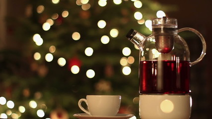 Glass teapot against Christmas background