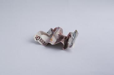 Wrinkled 10 Euro banknote on white background