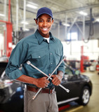 Mechanic with wrench in garage.