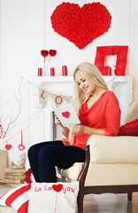 blonde reading a greeting card