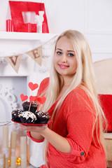 blonde holding dessert for Valentines Day