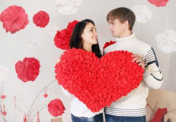 couple holding big heart