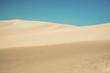 Zdjęcia na płótnie, fototapety, obrazy : Abstract big sand dunes with clear blue sky. Port Alfred. Easter