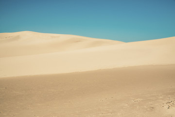 Abstract big sand dunes with clear blue sky. Port Alfred. Easter