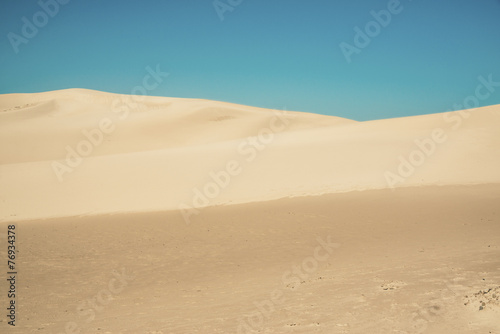 Fotobehang Woestijn Abstract big sand dunes with clear blue sky. Port Alfred. Easter