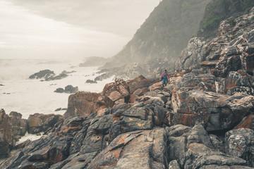 Female tourist hiking along the wild coast of Tsitsikamma Nation