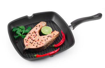 Frying pan with salmon steak