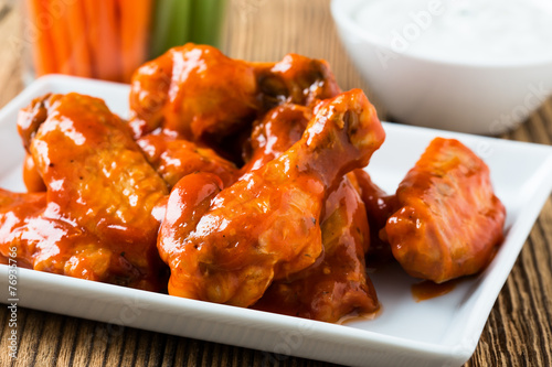 Fototapeta Buffalo chicken wing with cayenne pepper sauce