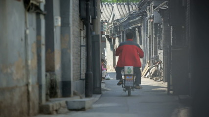 Moped rider buildings Chinese street China East Asia