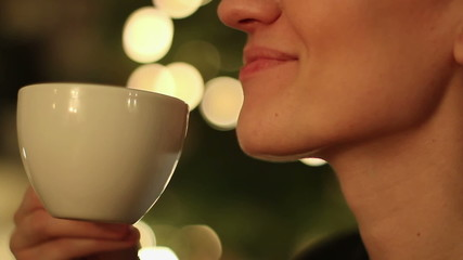 Happy young woman with coffee, close up