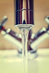 water tap with modern design in bathroom, vintage look