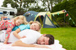 Father With Children Relaxing On Camping Holiday - 76939589