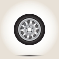 Car wheel with shadow on gray background