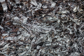 Wrinkled and charred aluminum foil