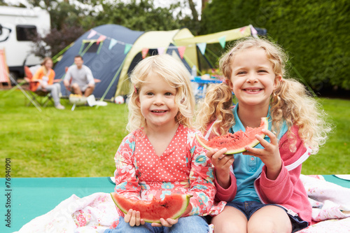 Tuinposter Kamperen Children Enjoying Picnic Whilst On Family Camping Holiday