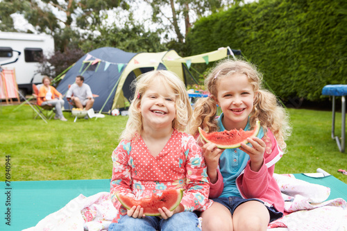 Fotobehang Kamperen Children Enjoying Picnic Whilst On Family Camping Holiday