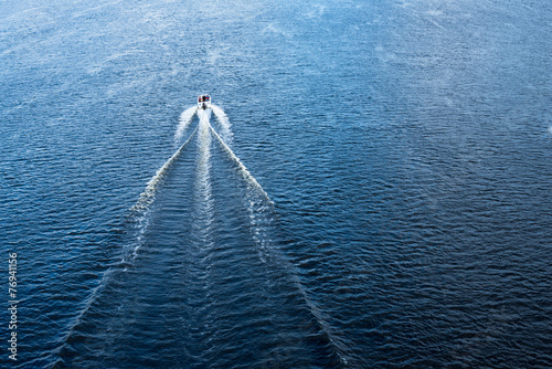 The motor boat floating in the blue Dnieper waters - 76941156