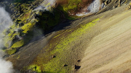 Aerial mountainous mineral colours steam venting volcanic Iceland