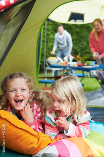 Tuinposter Kamperen Family Enjoying Camping Holiday On Campsite