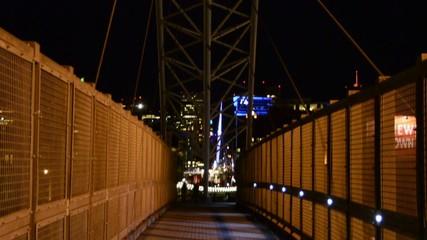 Tilt shot down a modern pedestrian bridge