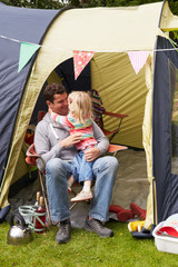 Father And Daughter Enjoying Camping Holiday On Campsite