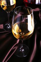 White wine glass on cloth close-up