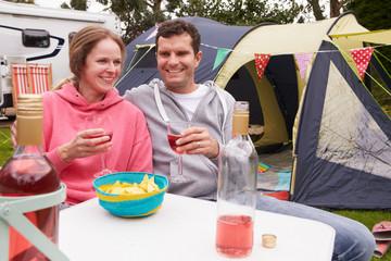 Couple Enjoying Camping Holiday On Campsite