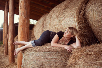 Attractive girl in the hay
