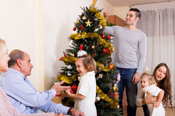family with decorated Christmas tree