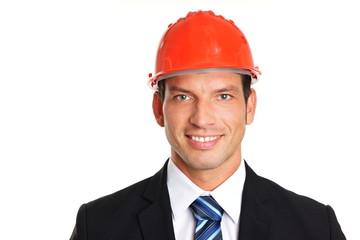 Smiling handsome businessman in a protective helmet
