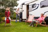 Family Enjoying Camping Holiday In Camper Van