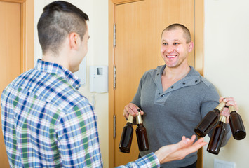 Friends gathering to drink beer at home