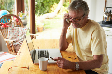 Mature Man Making On Line Purchase Using Credit Card