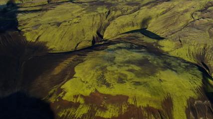 Aerial volcanic scarred highland region glacial erosion green Iceland