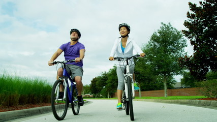 Asian Chinese Couple Exercise Outdoors Bicycles
