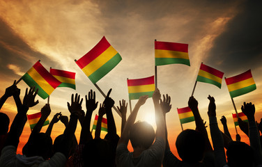 People Holding Red, Yellow and Green Striped Flag