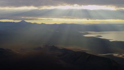 Aerial distant Katla volcano sunlight rays lake river delta Iceland