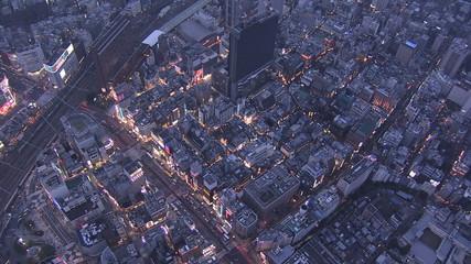 Aerial illuminated Shinjuku buildings lights Rail Track Tokyo Japan