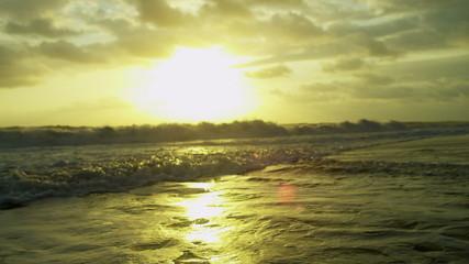 Tranquil Ocean Waves Under Gold Sunset