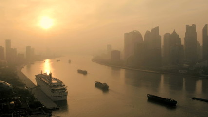 Sunset air pollution Huangpu River Pudong Shanghai China